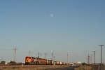 BNSF 5873 mty ct waits on the Red River sub at moonrise