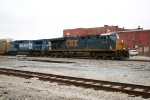 CSX 5456, 7334 passes by the Old Shoe Factory at Olney, IL.