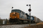 CSX 5456, 7334 roll past old B/O signal East of town.