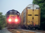 CSX 6111 and J759 wait to depart south as Q526 gets into the siding