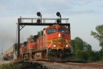 As the sunsets BNSF 5292 passes under the Old Santa Fe Signal bridge just in time.