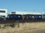 MRL 328 and MRL 406 sitting along railshops