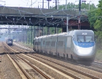 Acela about to pass another Amtrak train