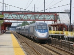 Northbound Acela flying through the station