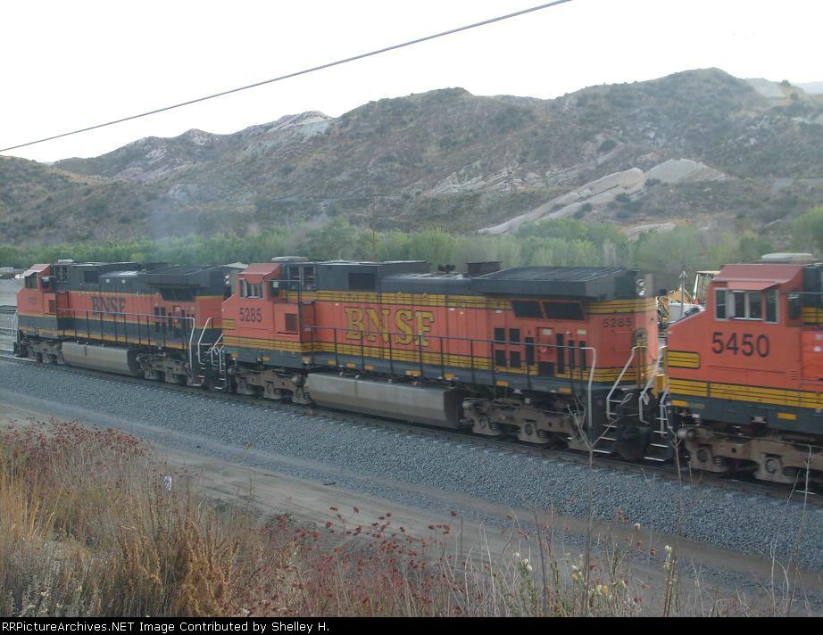 3 Engines pulling a long train