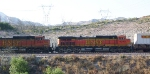 BNSF engines pulling a very long train