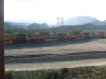 A BNSF train releasing the brakes going down the hill