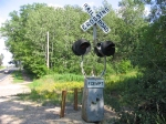 This Griswold crossing is located on the Dan Patch Line and the former MN&S Main. It is now left abandoned and has not seen a train in years. You can see where the rotaing banner used to sit which has long been removed.