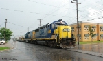 Oh Yeah, did I mention its raining again??? CSX 6956 backs the front of the train back downtown to the Port.