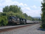 A westbound NS van train with a brand new SD70M as the trailing  engine on the ex PRR