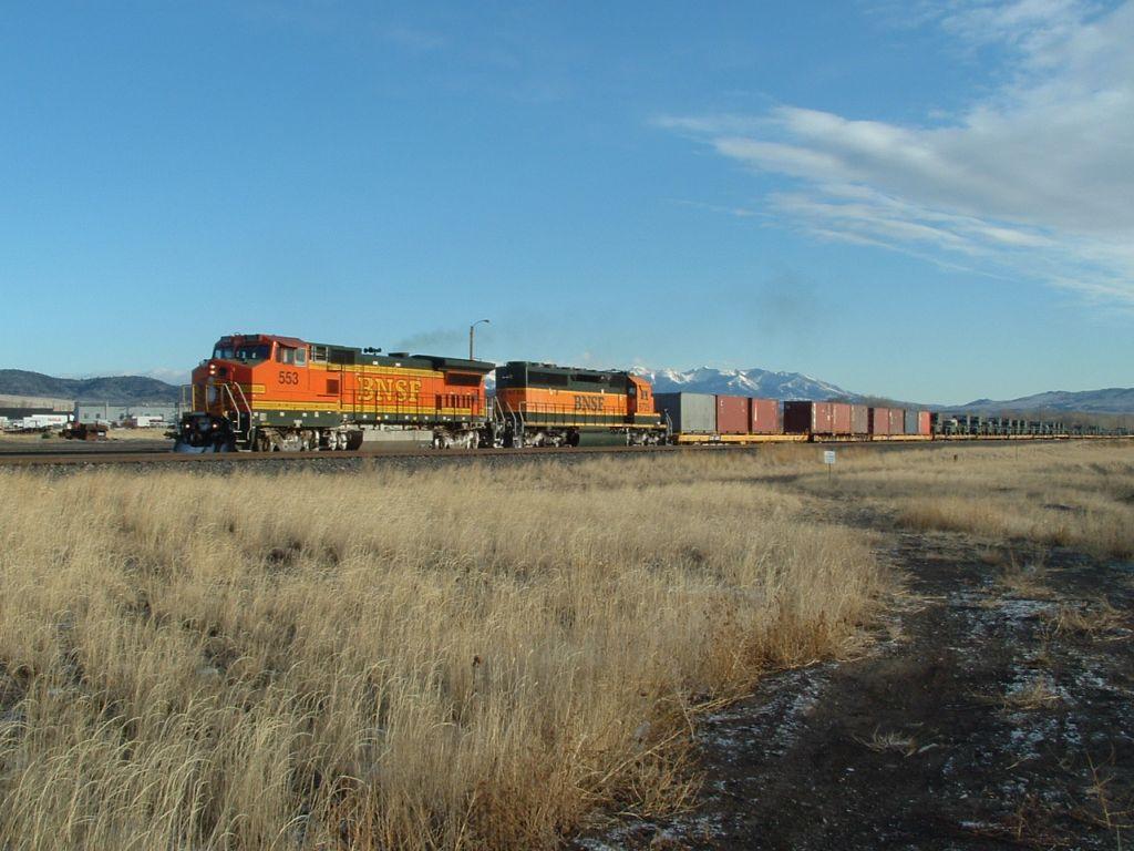 BNSF 553 hauling military equipment west