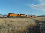 BNSF 553 hauling military equipment west