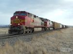 BNSF 738 and BNSF 619 with a long load