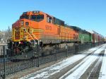 BNSF 5010 C44-9W with excess height cars trailing
