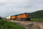 BNSF 5529 leads the eastbound doublestacks approaching Limery Road