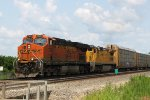 BNSF 7300 now underway with the eastbound autorack train approaching Highway K