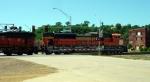 BNSF 9198 rolls slowly across Jones St.