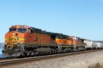 BNSF 4445 east with an elusive Geep splitting the Dash 9s