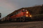 Down low for BNSF 7176 east passing Frechman's Landing Campground at dusk