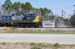 CSX 117 leads K913-24 past the entrance to Deerhaven Generating Station