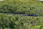 NS 8424 (ex Conrail) glides a string of hoppers around the curve.