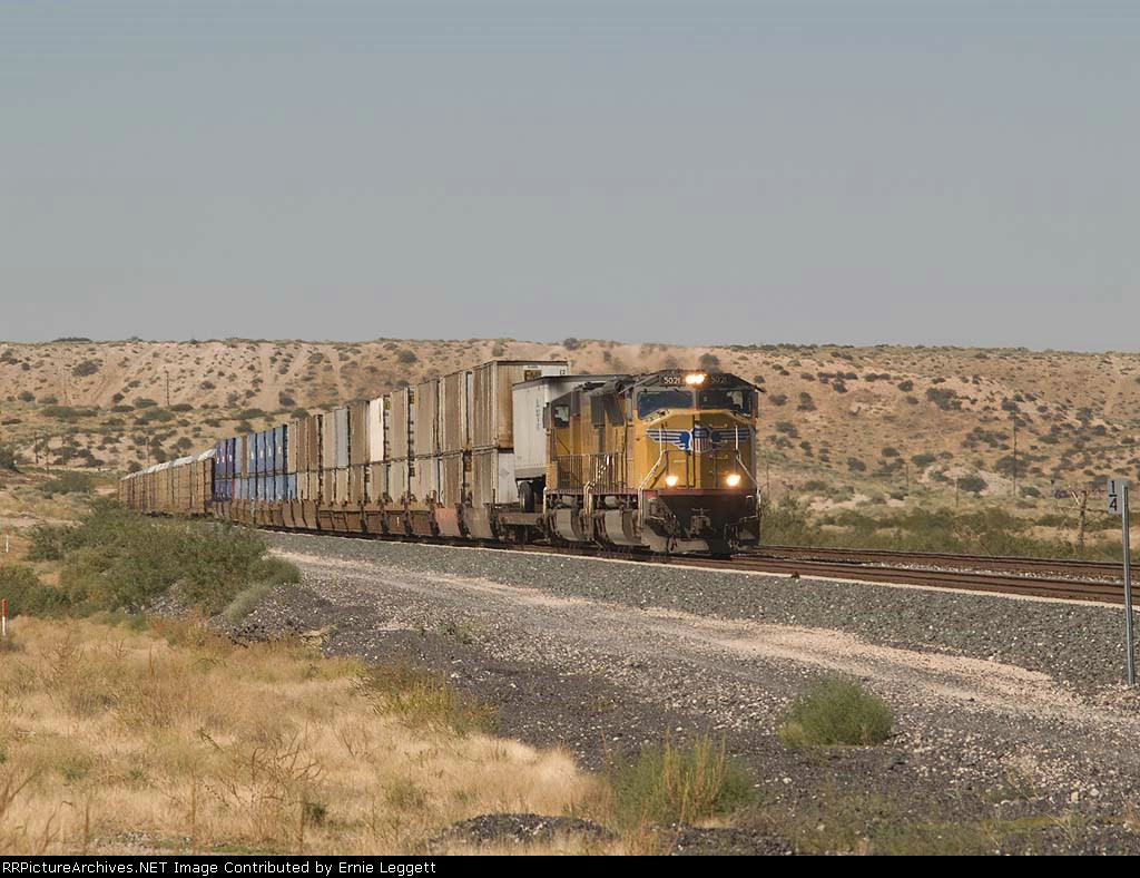 UP 5021 leads an EB doublestack/autorack at 12:54pm