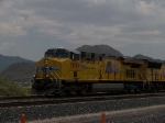 UP 7699 leads a WB doublestack at 1:31pm