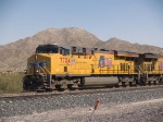 UP 7704 leads a WB doublestack at 1:20pm