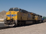 UP 7728 leads an EB doublestack at 11:22am
