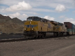 UP 7733 leads an EB IHJMN-26 doublestack at 11:11am