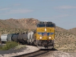 UP 7676 leads an EB manifest QWCEW at 11:51am