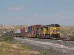 UP 7607 leads an EB doublestack at 12:09pm