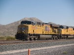UP 5283 leads a WB doublestack at 12:42pm