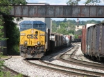 Q335-08 rolls under the old interurban bridge as it concludes its journey