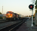 A BNSF train rumbling through the station