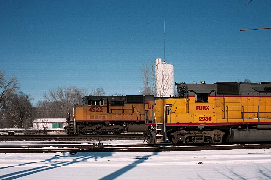 UP 4522 passes the local
