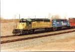 A dirty SD40-2 leads a similar CR uniut as train TV 556 gets yarded at Croxton Yard