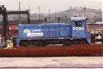 The metal banding on the carbody indicates this SW 7, fmr PC/PRR 9085 is retired