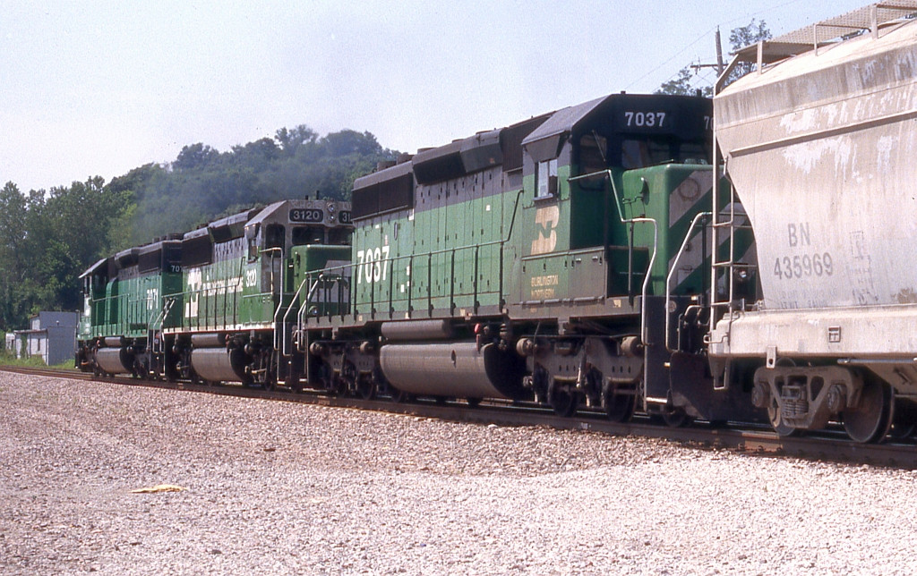 A trio of classic greenies on WB freight