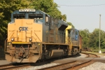 CSX 4841 and the E721 comes charging off the Old Main Line with a string of empty coal buckets