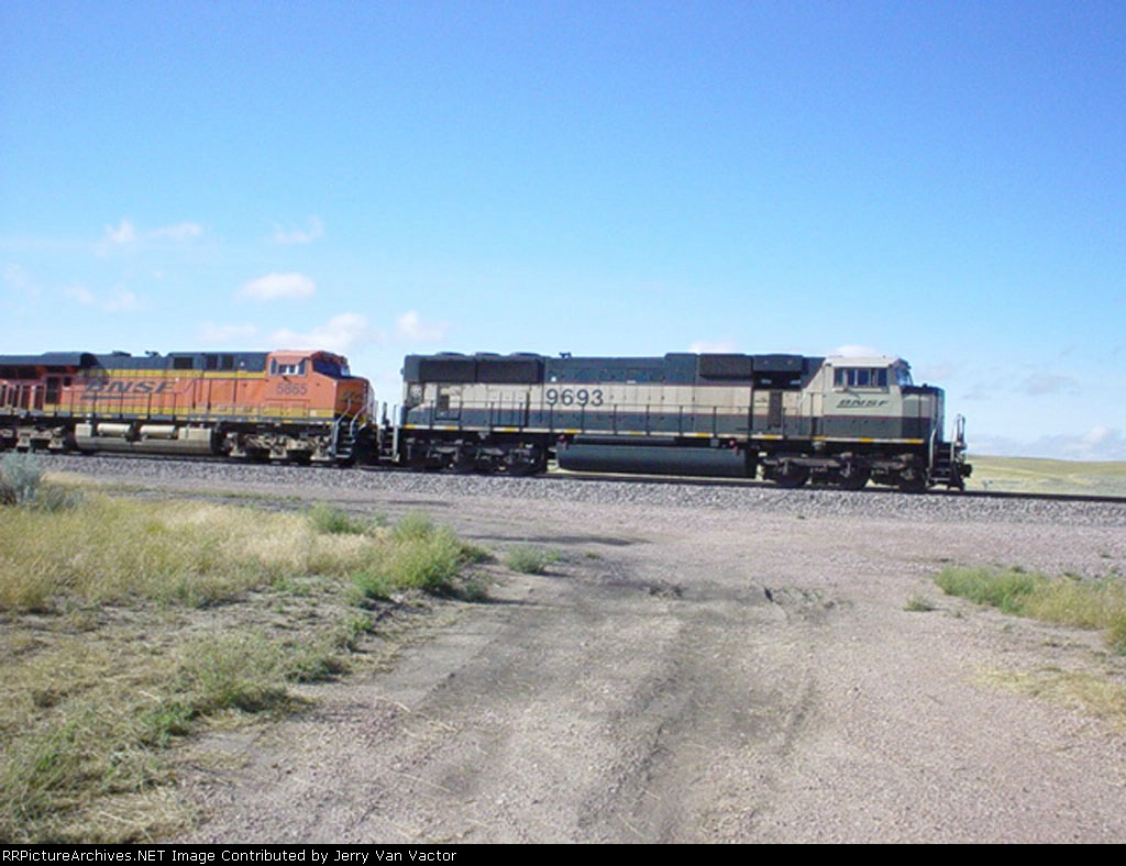 BNSF 5865 and 9693 wait for eb coal loads to appear