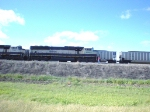 BNSF 9694 with empty hoppers waits for eb loads to pass