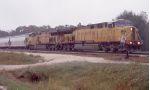 SB grain train in pouring rain