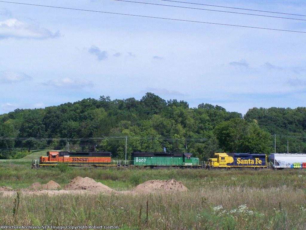 Fun Color Assortment Leads a Grain Train West on the Aurora Sub