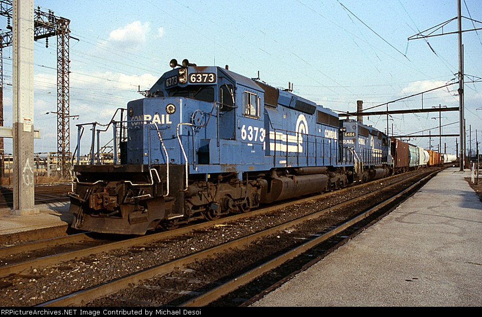 CR SD-40-2 #6373 leads a westbound at Frankford Junction