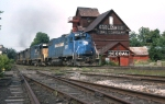 B&M 207 leads a freight past the classic Cobleskill Coal Co. building