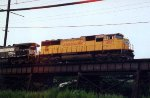 "UP SD-70M #4027 leads an eastbound on the ""woodwork"" about to cross the Delaware River"