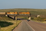 BNSF 6079 East crosses Highway 59