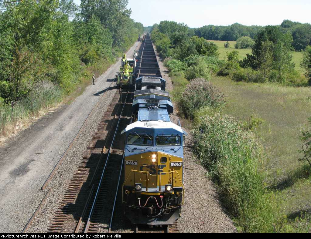 Break time!  CSX 785 leads an empty coal drag by the rail gang on the adjacent track