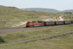 BNSF 9178 rounds the curve with it WB empty